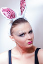 Easter bunny young woman looking serious easter eggs Royalty Free Stock Photography