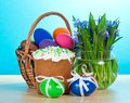 Easter cake, basket with eggs, flowers