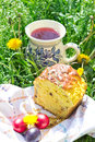 Easter cake, eggs and jug with compote