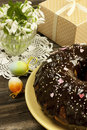 Easter cake with gift box and snowdrops chocolate raisins nuts on table Stock Image