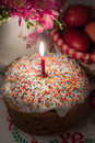 Easter cake with a lit candle on a celebratory table dark key Stock Images