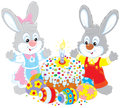 Easter cake and painted eggs bunnies celebrating with a fancy holiday colorfully Royalty Free Stock Photos
