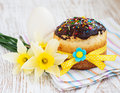 Easter cake traditional and spring flowers on a wood background Royalty Free Stock Photos