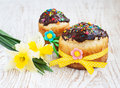 Easter cake traditional and spring flowers on a wood background Stock Photo