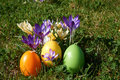 Easter candle in egg form between spring flowers Royalty Free Stock Photo