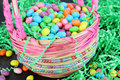 Easter candy in beaded Easter basket, close up. Royalty Free Stock Photo