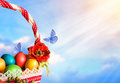 Easter card basket multicolored eggs butterflies sky empty space your text Royalty Free Stock Images
