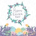 Happy Easter day card with eggs and a wreath flowers