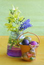 Easter card bunny eggs flowers stock photos holiday decoration with yellow and blue twigs in purple vase and orange bucket on Royalty Free Stock Image