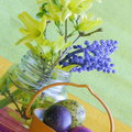 Easter card bunny eggs flowers stock photos holiday decoration with yellow and blue twigs in purple vase and orange bucket on Stock Images