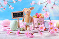 Easter card with clay rabbit  and decorations on sky background Royalty Free Stock Photo