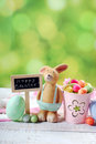 Easter card with clay rabbit  and decorations on spring backgrou Royalty Free Stock Photo