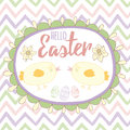 Easter card with cute hand drawn small chicken and text into oval frame with easter eggs and narcissus. Royalty Free Stock Photo