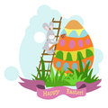 An Easter card hare, paint the egg in the green grass