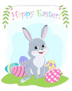 Easter card with the image of sitting on the grass rabbit, painted eggs, greeting labels and branches with leaves.