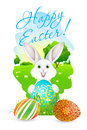 Easter card with landscape rabbit and decorated eggs grass Stock Photography