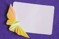 Easter card stock images yellow origami butterfly and white paper on blue background Royalty Free Stock Image