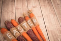 Easter carrots on a wooden background in rustic style
