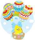 Easter chick flies with balloons little yellow chicken flying in a basket colored like eggs Stock Photo