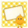 Easter chick and sign on gingham standing in front of a yellow background Royalty Free Stock Image