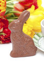 Easter chocolate bunny, tulips and tea Stock Images