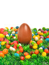 Easter chocolate egg caramels green grass isolated white background Stock Photo