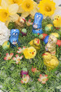 Easter chocolates on grass with narcissus Stock Photo