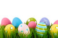 Easter colored eggs on the grass. Stock Images