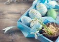 Easter. Colorful blue eggs and spring snowdrop flowers Royalty Free Stock Photo