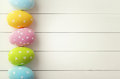 Easter colorful decorated eggs on wooden background Stock Image