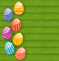 Easter colorful eggs on wooden texture illustration Stock Photos