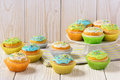 Easter colorful muffins on white table. Royalty Free Stock Photo
