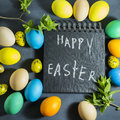 Easter composition with colorful eggs on a dark blue background.