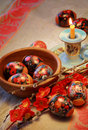 Easter composition colorful eggs willow branches burned candle and linen towel orthodox tradition Stock Photos