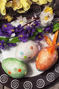 Easter composition with decorative eggs and flowers Stock Photos