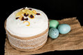 Easter composition of sweet bread, paska on black background. Holidays breakfast concept