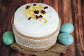 Easter composition of sweet bread, paska and eggs in wicker basket. Holidays breakfast concept