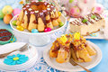 Easter confectionery assortment with marble ring cakes and cheesecake on festive table Stock Images
