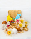 Easter cookie in a basket of flower narcissus and chicken egg on wooden background Stock Photography