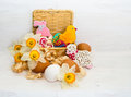 Easter cookie in a basket of flower narcissus and chicken egg on wooden background Royalty Free Stock Photos