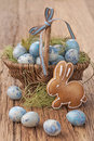 Easter cookie and blue eggs in a nest Stock Image