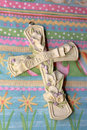 Easter cross sits top colored easter fabric Stock Image