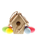 Easter decoration with birdhouse and colorful eggs over white background Royalty Free Stock Photos