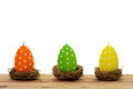 Easter decoration candles in the shape of eggs isolated on white background netst Stock Photography