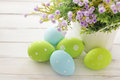 Easter decoration colorful eggs and spring flowers Stock Photos