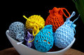 Easter decoration crocheted eggs on black background Stock Images