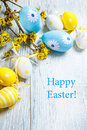 Easter decoration eggs and a yellow tree branch Stock Photo