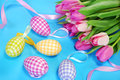 Easter decoration in pastel colors with eggs and fresh tulips Stock Images