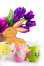 Easter decoration with rabbit eggs and tulips over white Stock Image