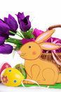 Easter decoration with rabbit eggs and tulips over white Stock Images